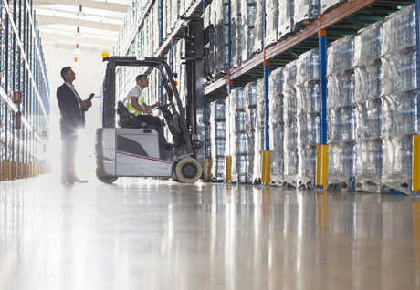 forklift driver and other worker in warehouse